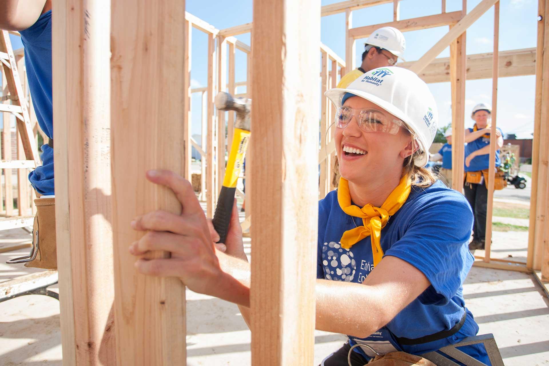 Happy volunteer on worksite